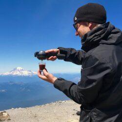 Joe brewing coffee at the summit